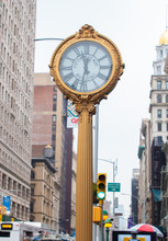 Cast Iron Street Clock On Fifth Avenue, Madison Square. Wide Angle Shot With Flatiron And Skyline, New York, USA