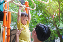 Father And Cute Little Asian 2 - 3 Years Old Toddler Baby Boy Child Having Fun Exercising Outdoor And Dad Help Catch Up On Monkey Bars Equipment At Playground On Nature At Park, Father's Day Concept