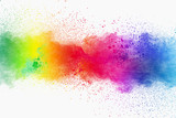 Fototapeta Rainbow - Colorful powder explosion on white background. Pastel color dust particle splashing.