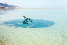 Dead Sea, Israel. White Lounge Chair Floating In The Water.