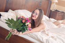 Young Woman With A Bouquet Of ...