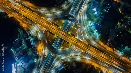 Spoed Fotobehang Nacht snelweg Aerial view of the circle and expressway, motorway and highway in intersection