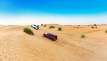 Jeep Safari  Over Sand Dunes In Dubai Desert Conservation Reserve, United Arab Emirates. Copy Space For Text.