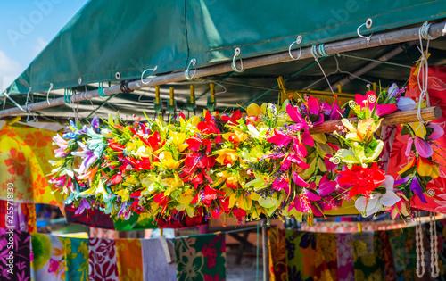 Fotografie, Obraz  Flower wreaths on the local market, Rarotonga, Aitutaki, Cook Islands