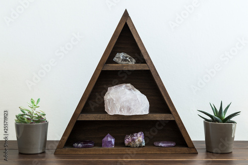 Triangular Crystal Shelf with Succulent Plants either side on a Wooden Surface Canvas Print