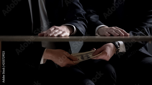 Canvas Print Politician hands taking bribe money under office table, lobbying of interests