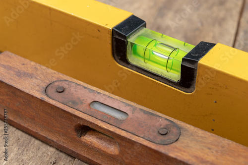 Fotografie, Obraz  Measuring the slope of a surface using a spirit level