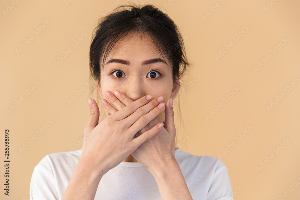 Fototapety, obrazy: Image of silent chinese woman wearing basic t-shirt covering her mouth with hands