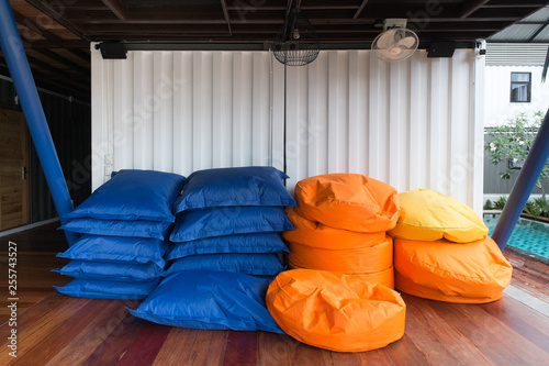 Strange Colorful Pile Of Bean Bags With White Container Wall Buy Pdpeps Interior Chair Design Pdpepsorg