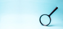 Magnifying Glass On Blue Backg...