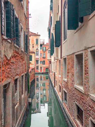 Small romantic canal, old buildings and traditional venetian houses © Ирина Лаврищева