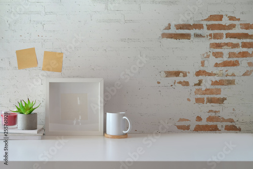 Fotografia  Mockup poster on workspace and copy space..