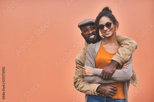 Smiling afro American man embracing his girlfriend with love Canvas Print