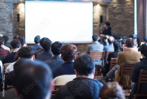 Business Conference Photo  Executive Speaker on Stage