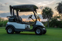 Golf Cart On Florida Golf Course At Sunset