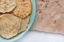Corn Tortilla With Coriander On A Stone And White Background
