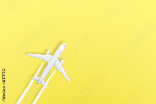 canvas print motiv - aapsky : Yellow pastel paper airplane on background. Minimal concept.