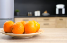 Fresh Oranges On Wooden Table ...