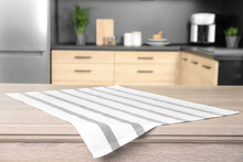 Napkin On Wooden Table In Kitchen. Mockup For Design