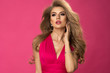 canvas print picture - Beauty blonde woman wear pink dress, over pink wall