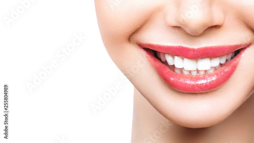 Stampa su Tela  Beautiful wide smile of young fresh woman with great healthy white teeth