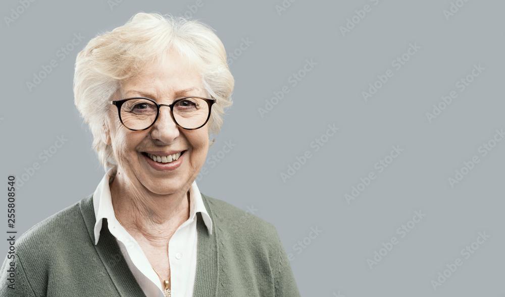 Fototapety, obrazy: Happy senior woman posing on gray background
