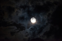 Moon Through The Clouds At Nig...