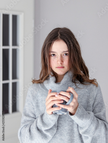 Vertical Portrait Of Beautiful Tween Girl In Warm Grey Pullover Holding Cup Tea Looking At Camera Home Natural Beauty Without Make Up Stock Photo Adobe
