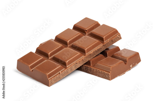 Canvastavla Pieces of milk chocolate bar isolated on white background