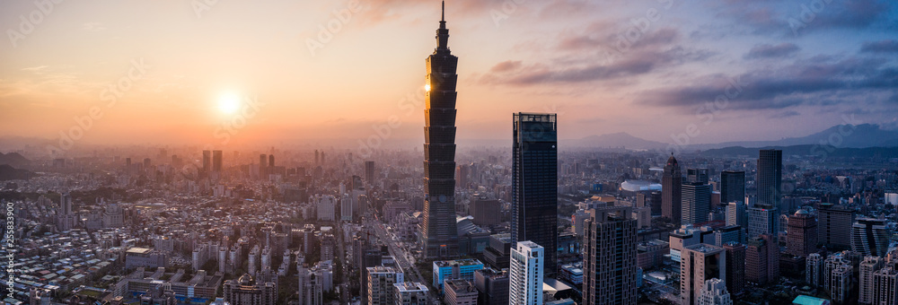 Fototapeta Aerial drone panorama photo - Sunset over the city of Taipei, Taiwan.  Taipei 101 skyscraper featured.