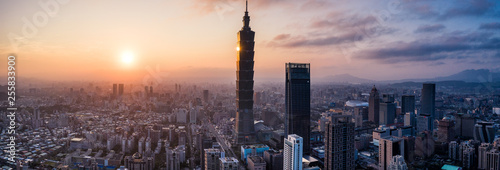 Aerial drone panorama photo - Sunset over the city of Taipei, Taiwan. Taipei 101 skyscraper featured.