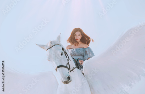 Fototapeta bright sky and sunlight, majestic girl with dark flying hair riding horse, an an
