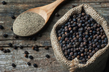 Heap Of Black Pepper And Black Pepper Powder, Milled Peppercorns On Wooden Background, Dried Spice Pepper Corn Concept
