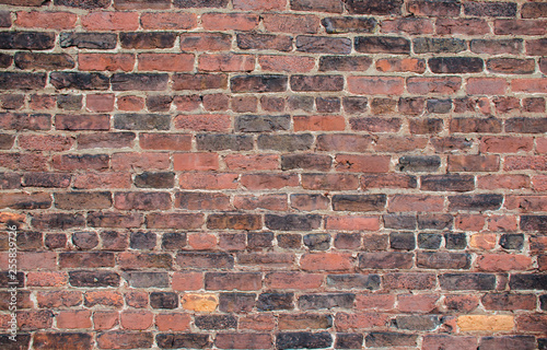Brick industrial wall, excellent background. Color and detail in this beautiful vintage brick wall, built years ago. Cracked and aged surface of textured brick wall.