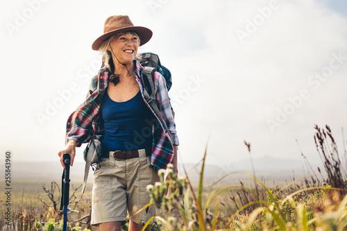 Cheerful senior woman enjoying her hiking trip