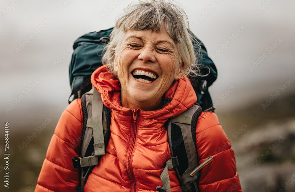 Fototapeta Senior woman enjoying her hiking trip