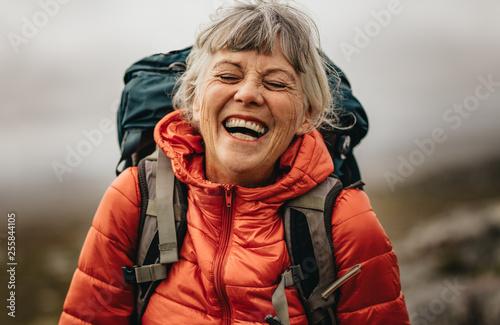Obraz na plátně Senior woman enjoying her hiking trip