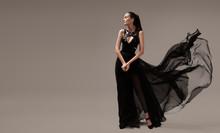 Beautiful Woman In Luxury Evening Black Dress. Gray Background.