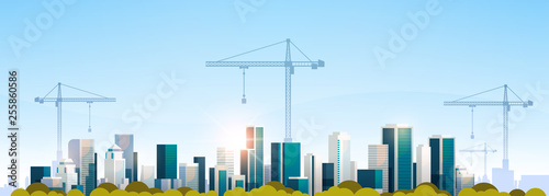 Fotografía  modern city construction site tower cranes building residential buildings citysc