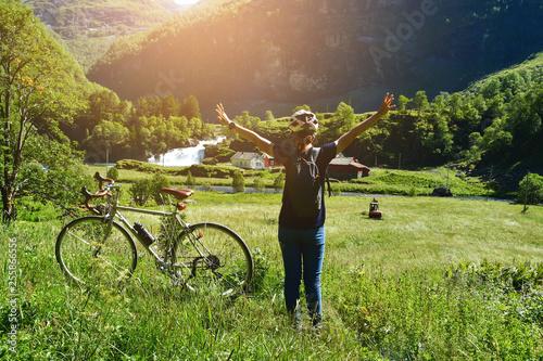 Fototapeta people ride bicycle on mountain road at flam Norway