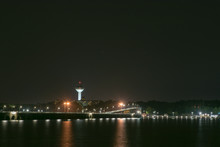 Nighttime Over Tennessee River Between Muscle Shoals And Florence, Alabama With The Renaissance Tower And Wilson Dam