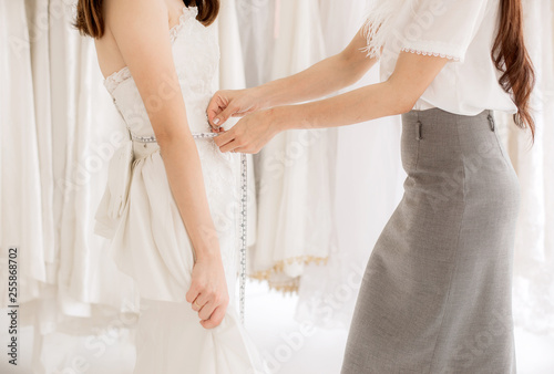 Asian Woman Bride Trying On Wedding Dress Women Tailor