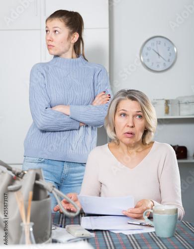 Fotografía  Unhappy woman with documents, family quarrel