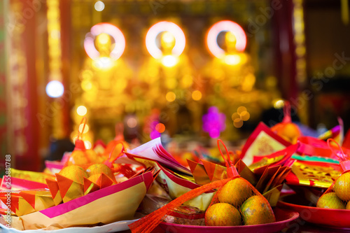 Fotografie, Obraz  Close up of Traditional Chinese talisman and orange fruit for pay homage to god's lucky in chinese temple, Selective focus
