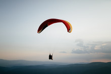 Hang Glider Pilot In Mountains