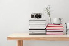 Many Books, Photo Camera And C...