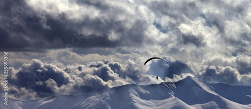 Fotografie, Obraz  Evening mountain with clouds and silhouette of parachutist