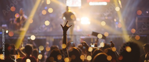 Celebrate. Party People Rock Concert. Crowd Happy and Joyful and Applauding or Clapping. Celebration party festival happiness. Blurry night club. Concert Show with DJ Music festival EDM on Stage .