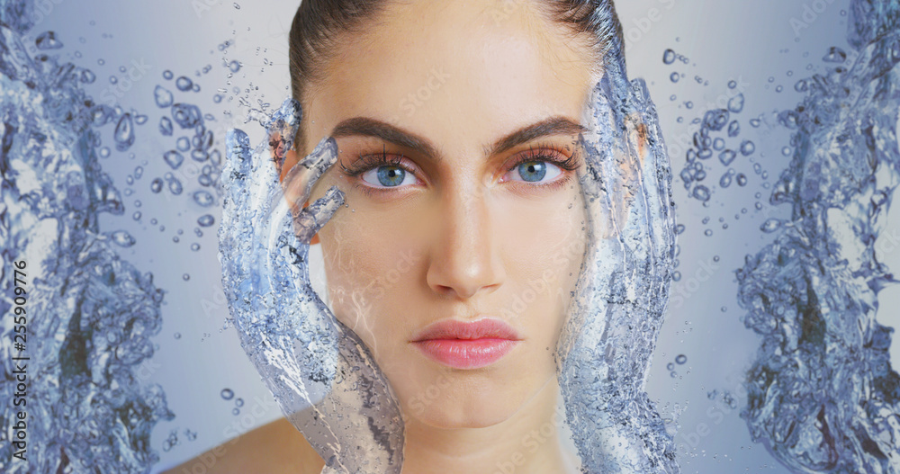 Fototapeta Portrait of woman with beautiful face and perfect skin just cleaned from impurities touching it gently with 3d water hands to show how soft, smooth and pure  it is.