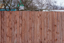 Fence Of Painted Boards Around...